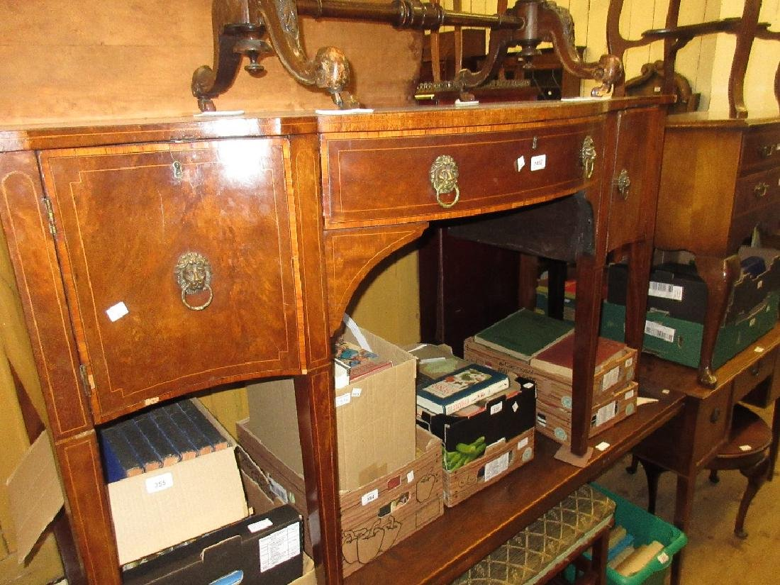 George III mahogany serpentine shaped sideboard with