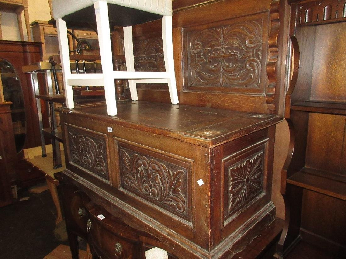 Late 19th Century carved oak monks bench, the fold-over