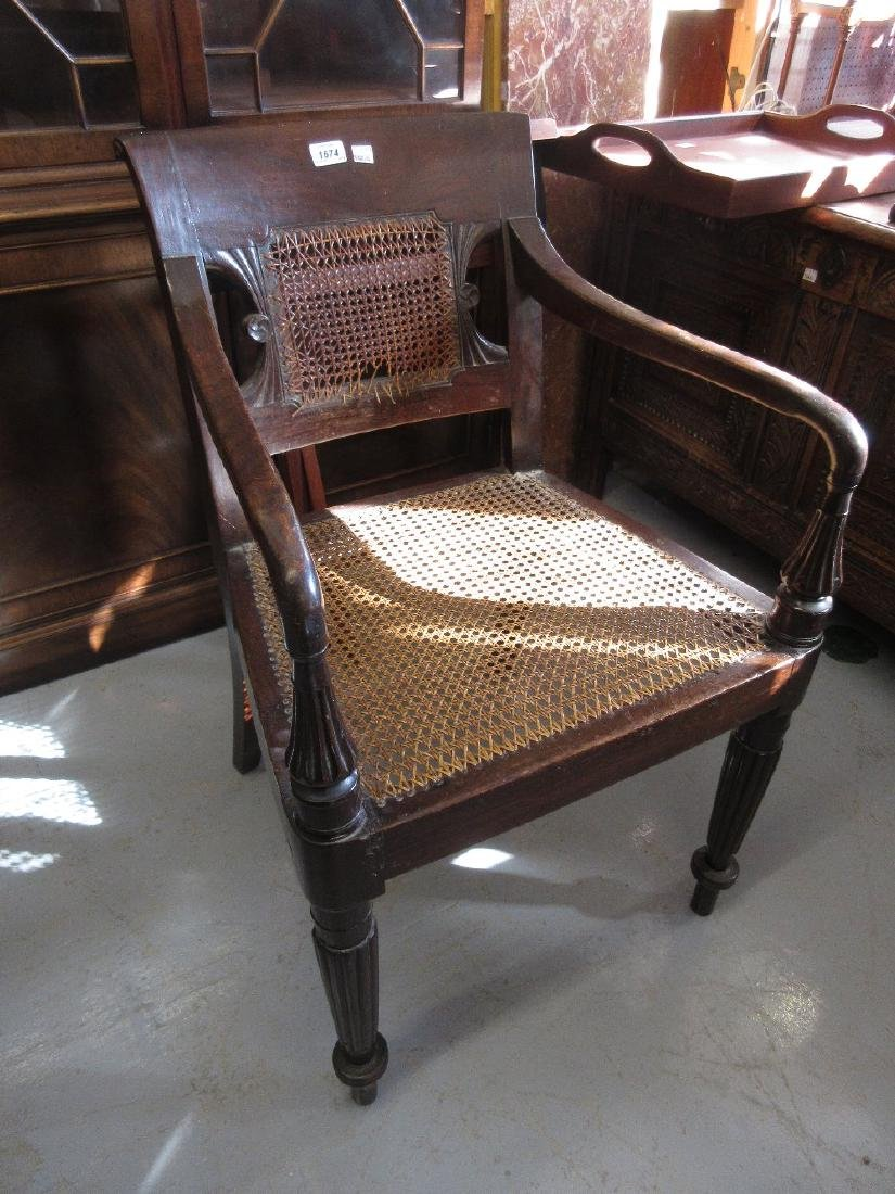 Regency mahogany open elbow chair with caned back and