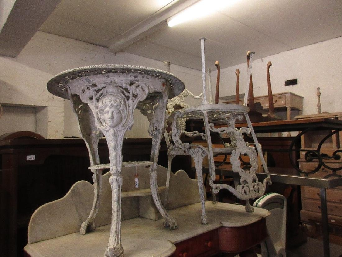 White painted cast alloy garden table and pair of