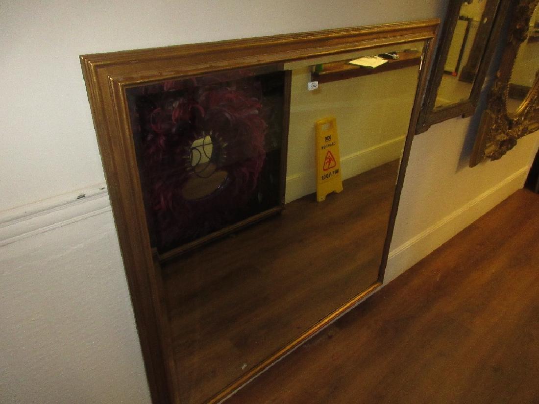 Large modern rectangular gilt framed wall mirror with