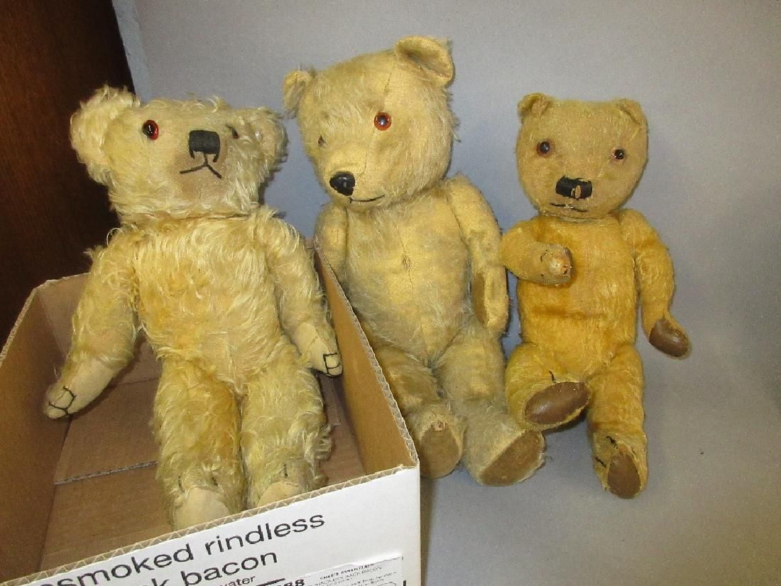 Three plush covered jointed teddy bears with glass eyes
