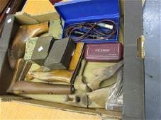 Box containing a small quantity of various shoe lasts