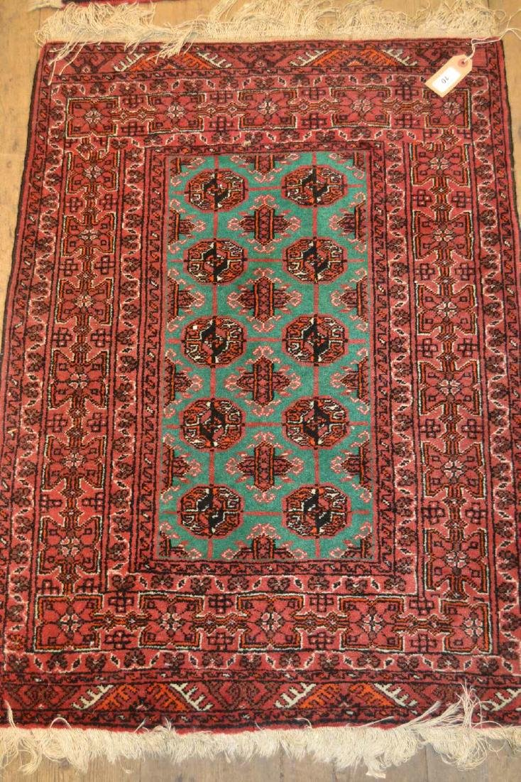 Small Turkoman style rug with two rows of five gols on