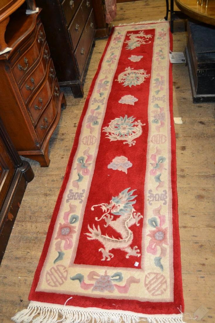 Two 20th Century Chinese red ground runners