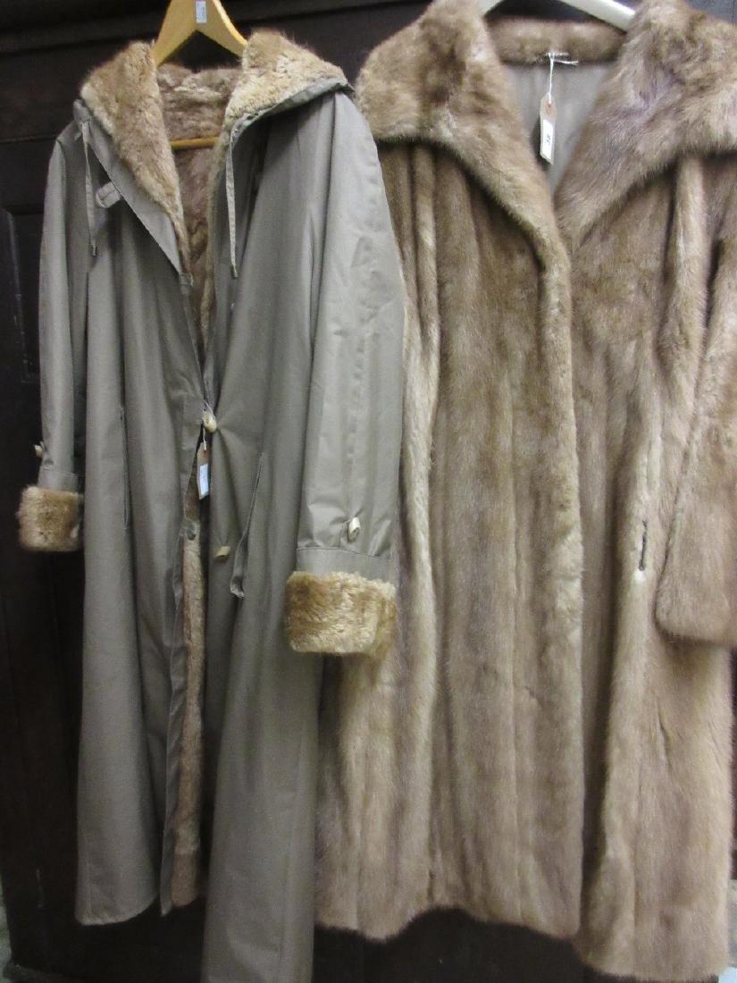 Ladies mid brown three quarter length fur coat together
