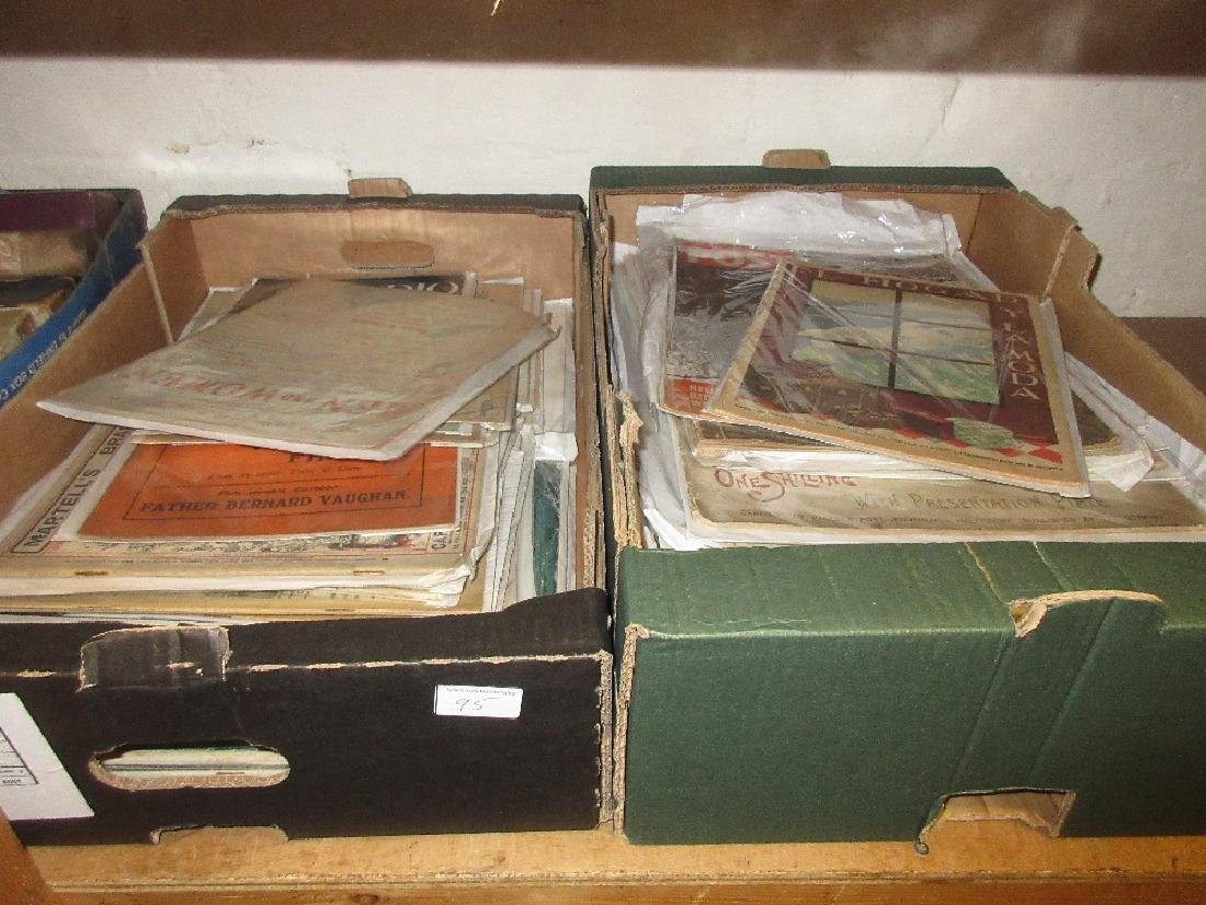 Two boxes containing a collection of magazines and