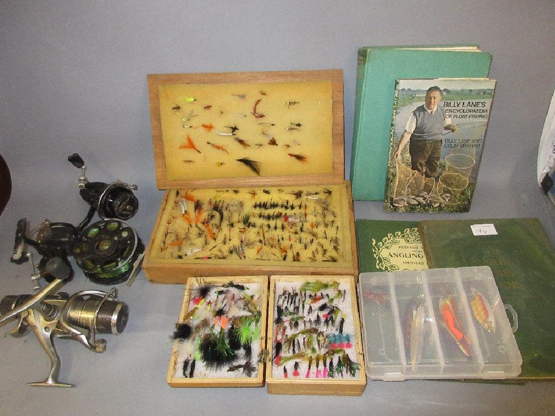 Two boxes containing a collection of fishing flies