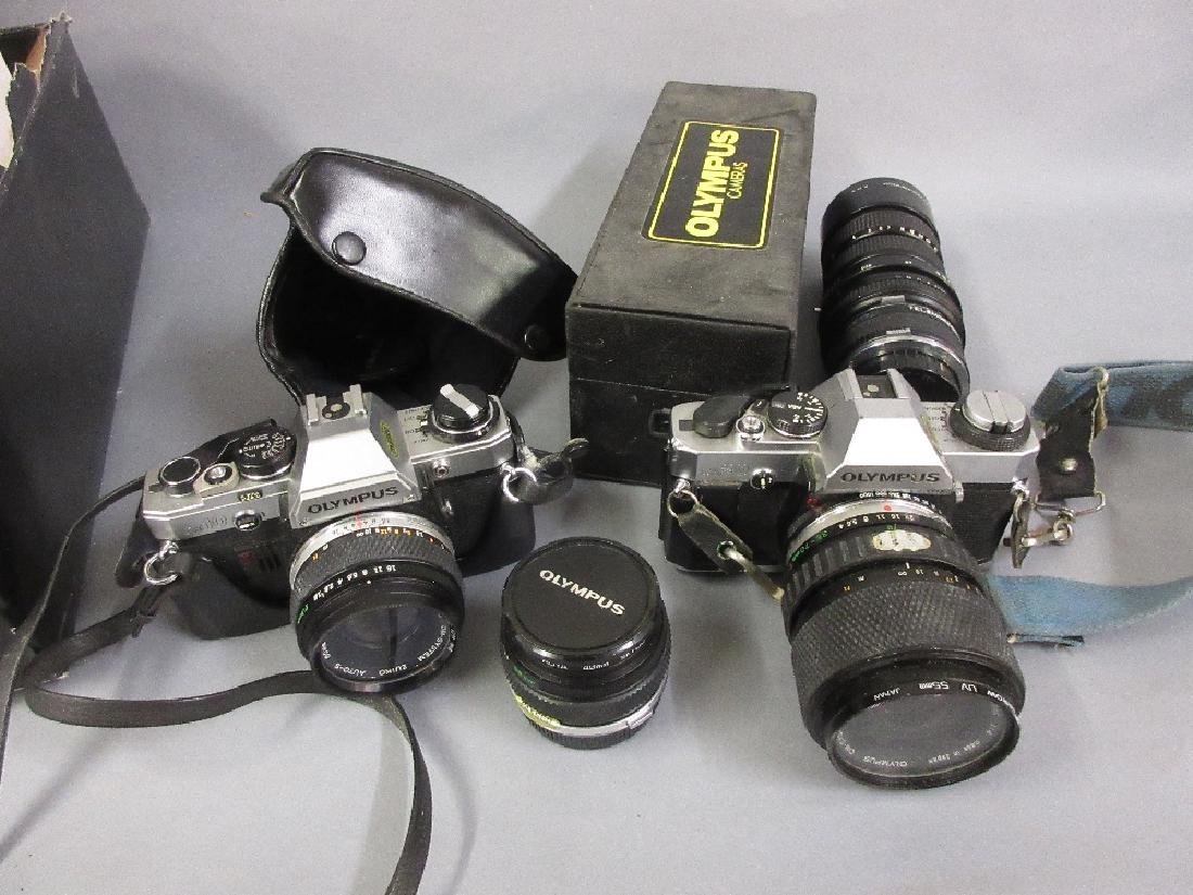 Olympus OM20 SLR camera with lens, another SLR camera,