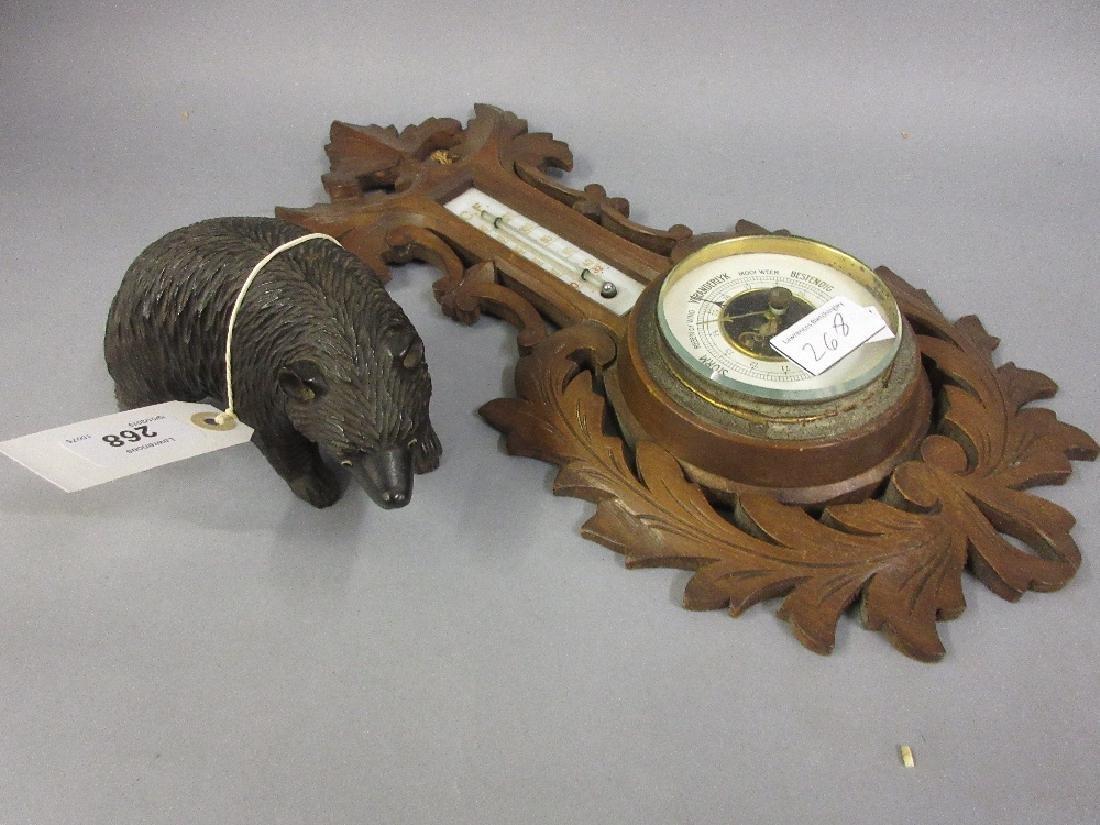 Black Forest carved wooden figure of a bear together
