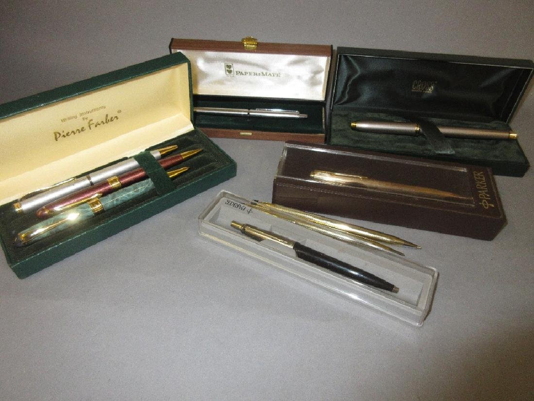 Collection of writing instruments by Parker, Cross,