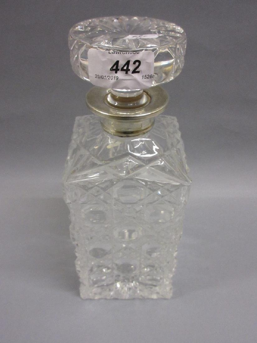 Square cut glass decanter with stopper having a silver