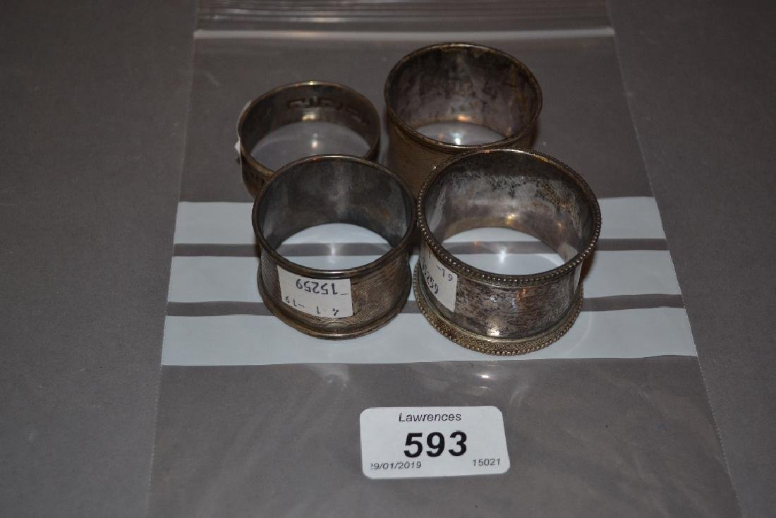 Four various silver napkin rings