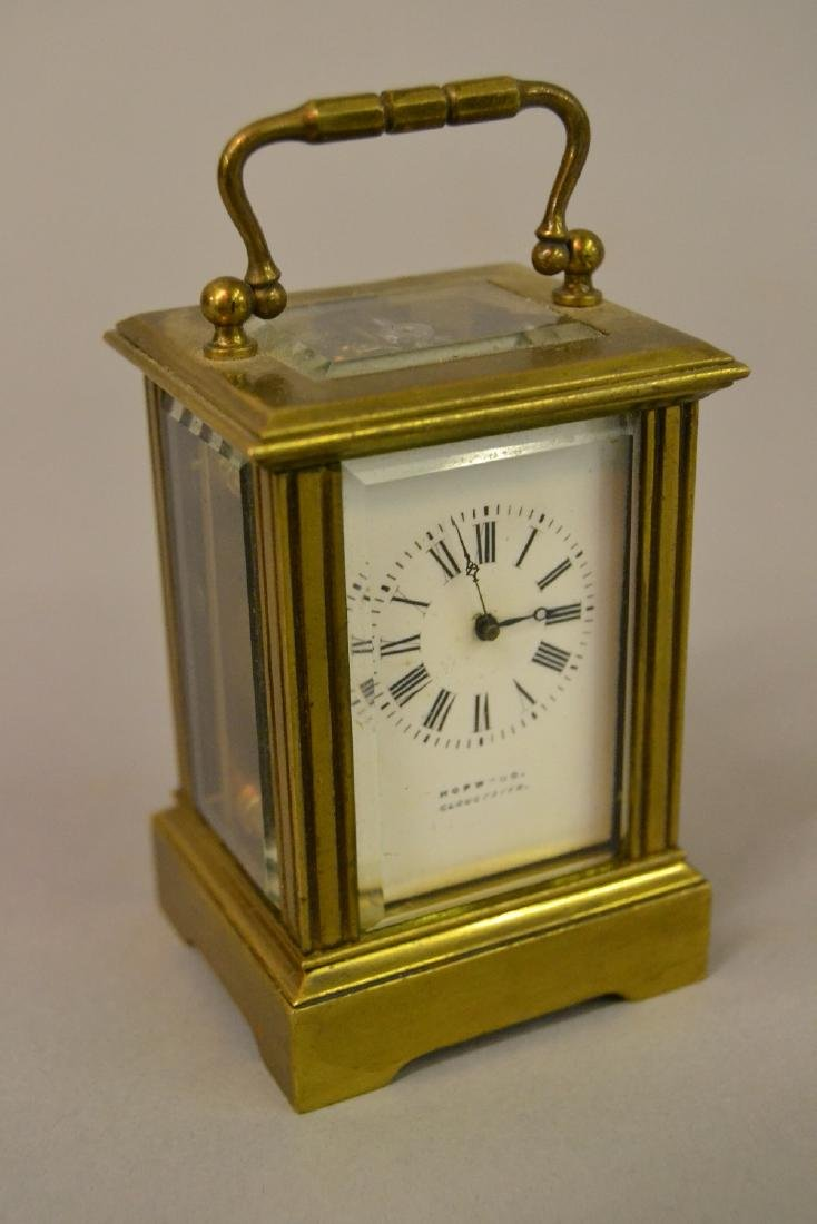 Miniature brass cased carriage clock, the enamel dial