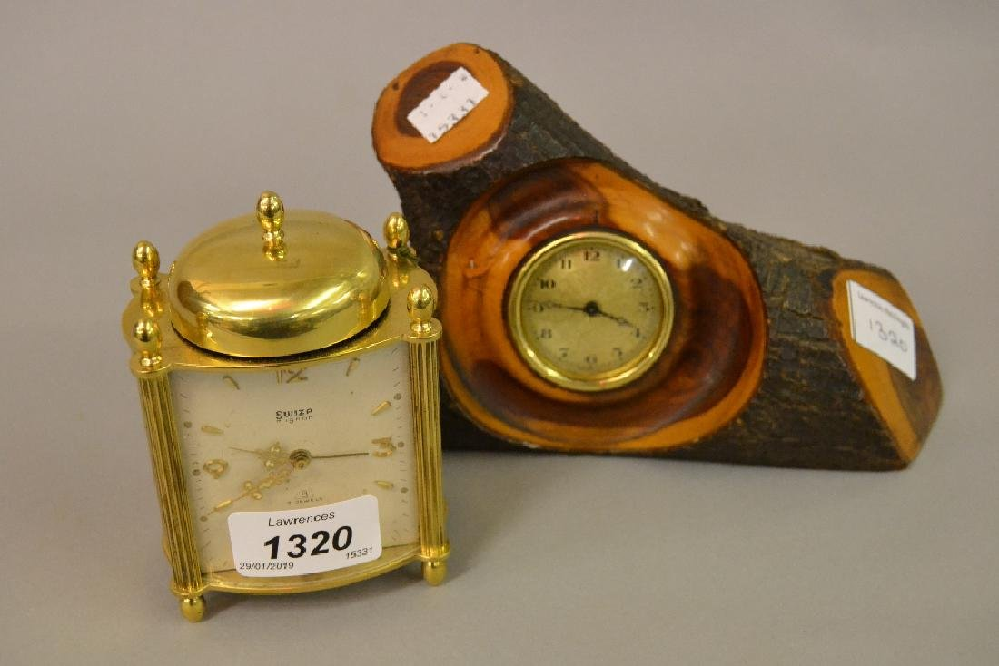 Swiza brass alarm clock together with a small clock