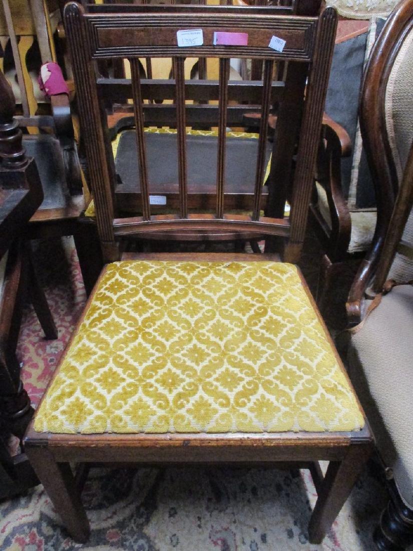 Set of three George III mahogany side chairs together