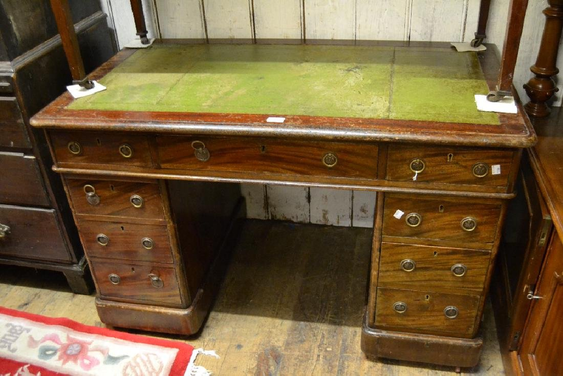 19th Century mahogany twin pedestal desk with a leather