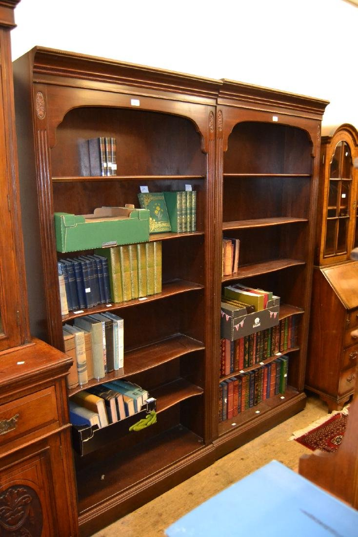 Pair of reproduction mahogany six shelf open bookcases