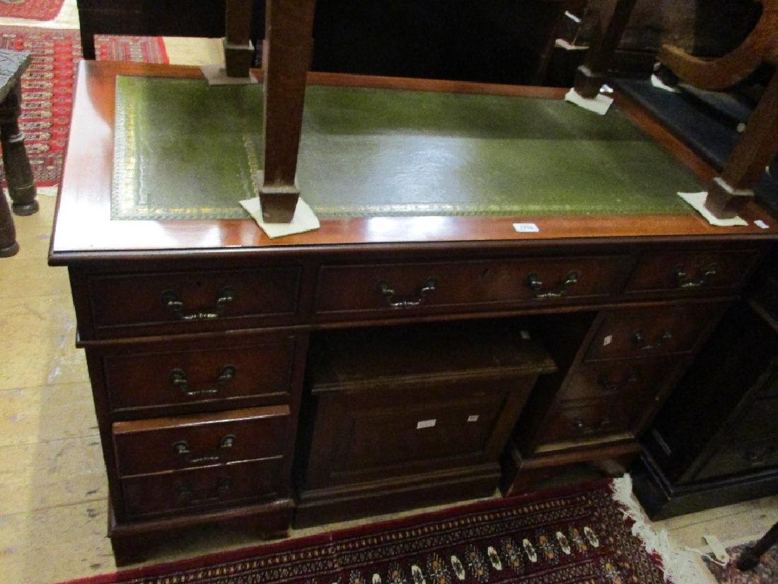 Reproduction mahogany twin pedestal desk with a green
