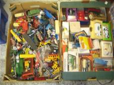 Two boxes containing a collection of various Dinky and