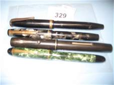 Four various vintage fountain pens with 14ct gold nibs