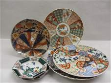 Group of four various Imari chargers with blue, red and