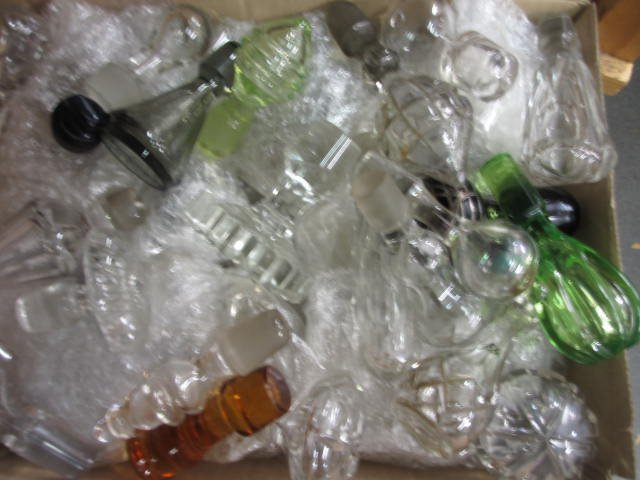 Large quantity of various glass decanter stoppers