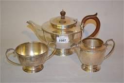 London silver circular three piece tea service, makers