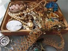 Small box containing a quantity of various costume