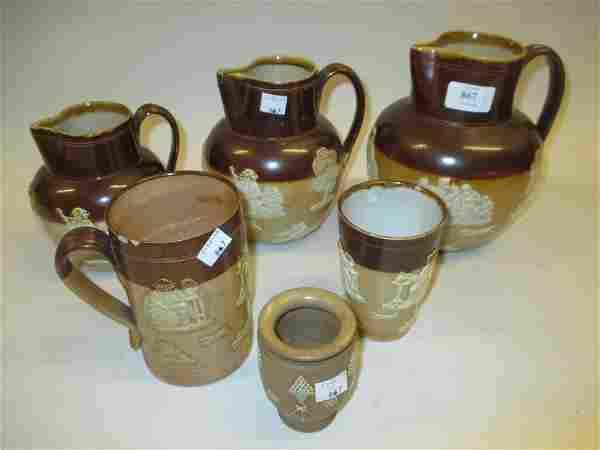 Graduated set of three Royal Doulton stoneware jugs,