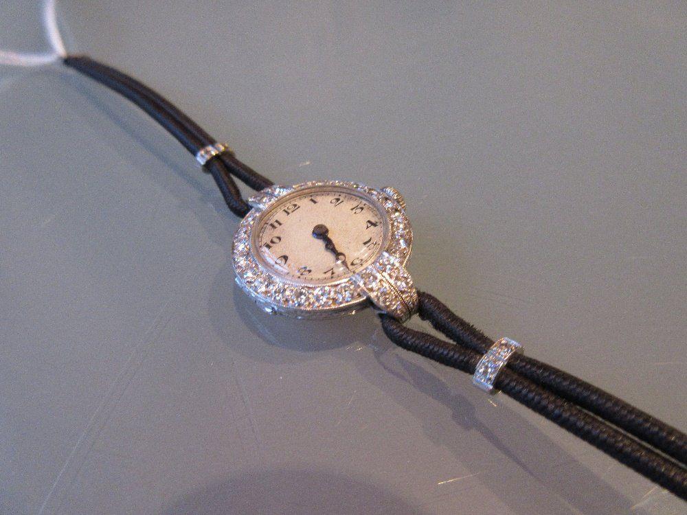 Ladies platinum and diamond set cocktail wristwatch by