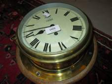 Mid 20th Century brass cased ships bulkhead clock by