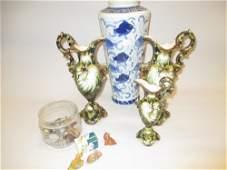 Garniture of three Austrian pottery shell form jug