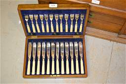 Small cased set of silver plated fish knives and forks