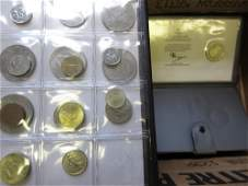 Two albums containing a collection of World coins, a