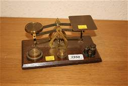 Small pair of early 20th Century oak and brass postal