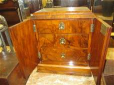 Victorian walnut table cabinet with two doors enclosing