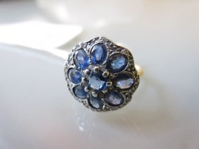 Circular Sapphire And Diamond Cluster Ring