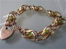 9ct Gold peridot set bracelet of Arts and Crafts design