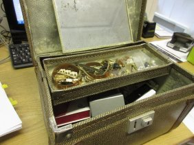 Small Case Containing A Quantity Of Various Costume
