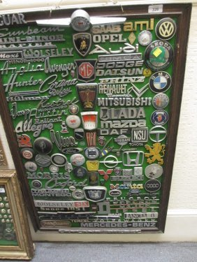 Collection Of 1970's Car Badges Mounted On A Board