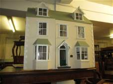 Good quality modern dolls house with hinged opening