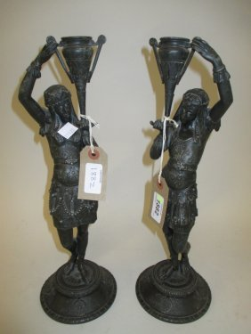 Pair Of Egyptianesque Spelter Figures On Circular Bases