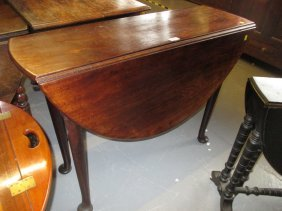 Mid 18th Century Mahogany Oval Drop-leaf Dining Table