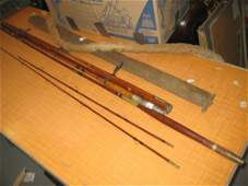 Two cased early 20th Century fishing rods