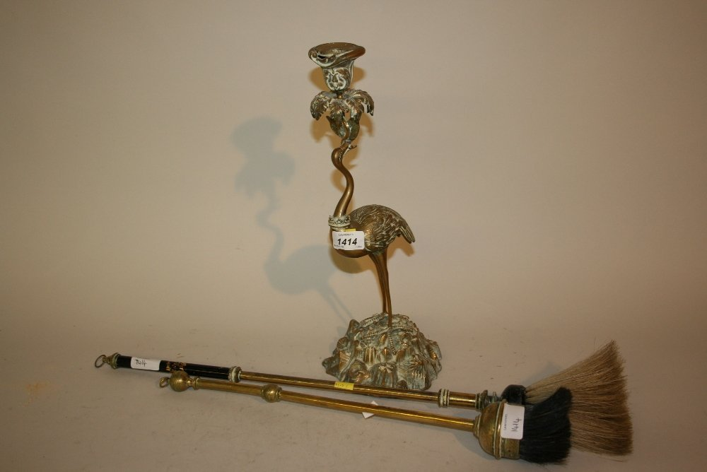 19th Century brass candlestick on heron support,