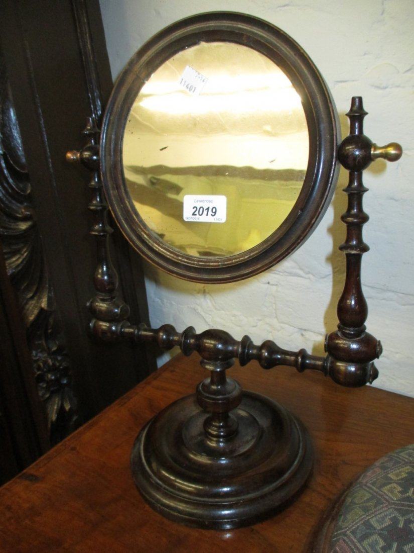 Stained and turned wooden shaving mirror on turned