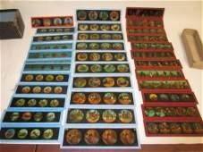 Quantity of various coloured magic lantern slides of