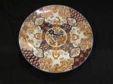 19th Century circular Imari charger, floral painted in