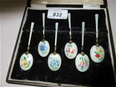 Cased set of six silver gilt floral enamel decorated